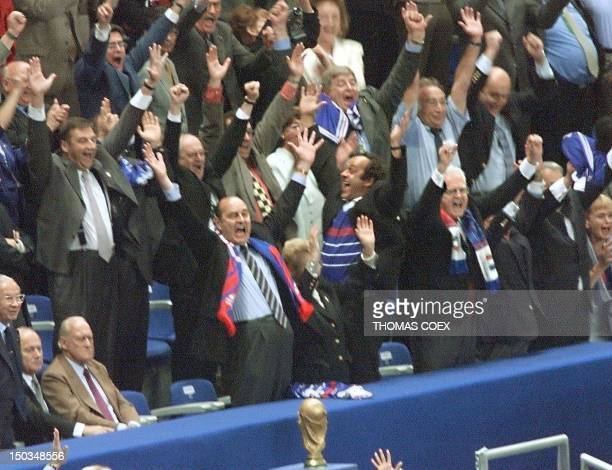 French president Jacques Chirac jublates with CFO copresident Michel Platini and French Prime minister Lionel Jospin 12 July at the Stade de France...