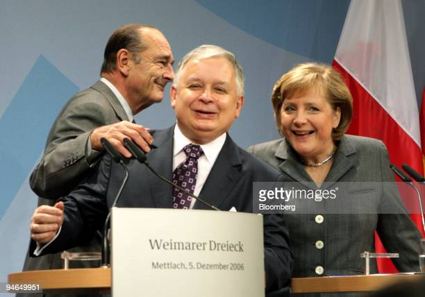 French President Jacques Chirac, left, Polish President Lech Kaczynski, center and German Chancellor Angela Merkel arrive for a press conference...