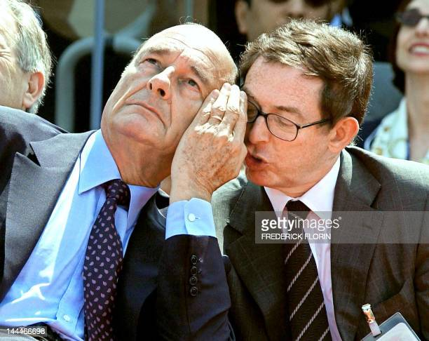 French President Jacques Chirac listens 14 June 2003 to Airbus Industries CEO Noël Forgeard at the 45th Aeronautic and Space Show in Le Bourget. AFP...