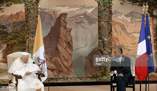 French President Jacques Chirac listens to Pope John Paul II during their meeting after the pontiff's arrival at the TarbesLourdesPyrenees airport...