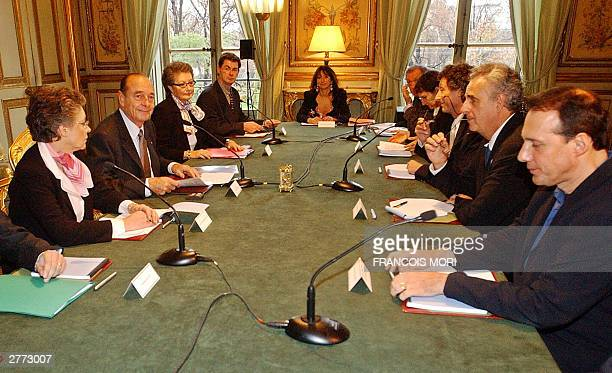 French President Jacques Chirac poses at the beginning of a work meeting about Aids with French doctors and professors 01 December 2003 at the Elysee...
