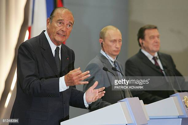 French President Jacques Chirac , Russian President Vladimir Putin and German Chancellor Gerhard Schroeder give a press conference 31 August 2004 in...