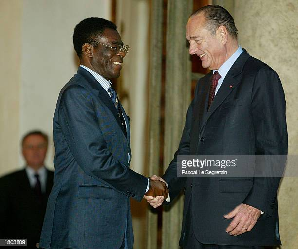 French President Jacques Chirac shakes hands with President of Equatorial Guinea Teodoro Obiang Nguema Mbasogo at the Elysee Palace February 19 ,...