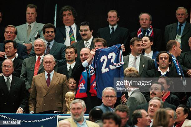 French President Jacques Chirac showing his French national team jersey prior to the 1998 FIFA World Cup final between France and Brazil | Location...