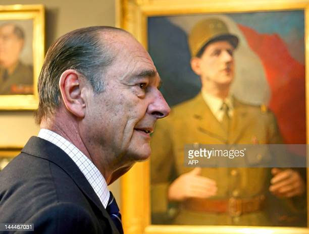French President Jacques Chirac stands in front of a portrait of General de Gaulle, former French President, during a visit to the museum of the...