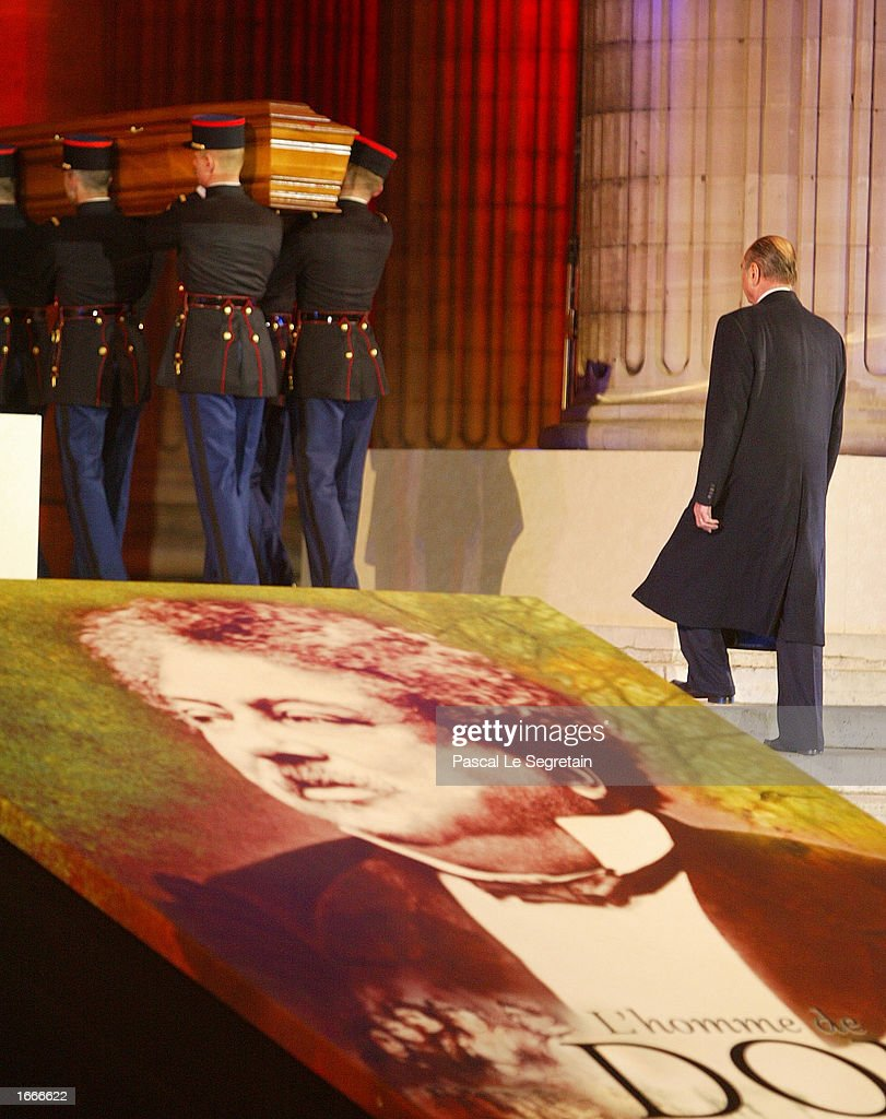 French President Jacques Chirac walks behind the coffin of author Alexandre Dumas during a ceremony to transfer Dumas' ashes to the Pantheon November 30, 2002 in Paris, France. The Pantheon is the traditional resting place of the remains of France's greatest historical and cultural figures.