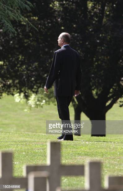 French President Jacques Chirac walks during a visit at Douaumont's first world war cemetery, near Verdun, eastern France, 25 June 2006. Chirac is in...