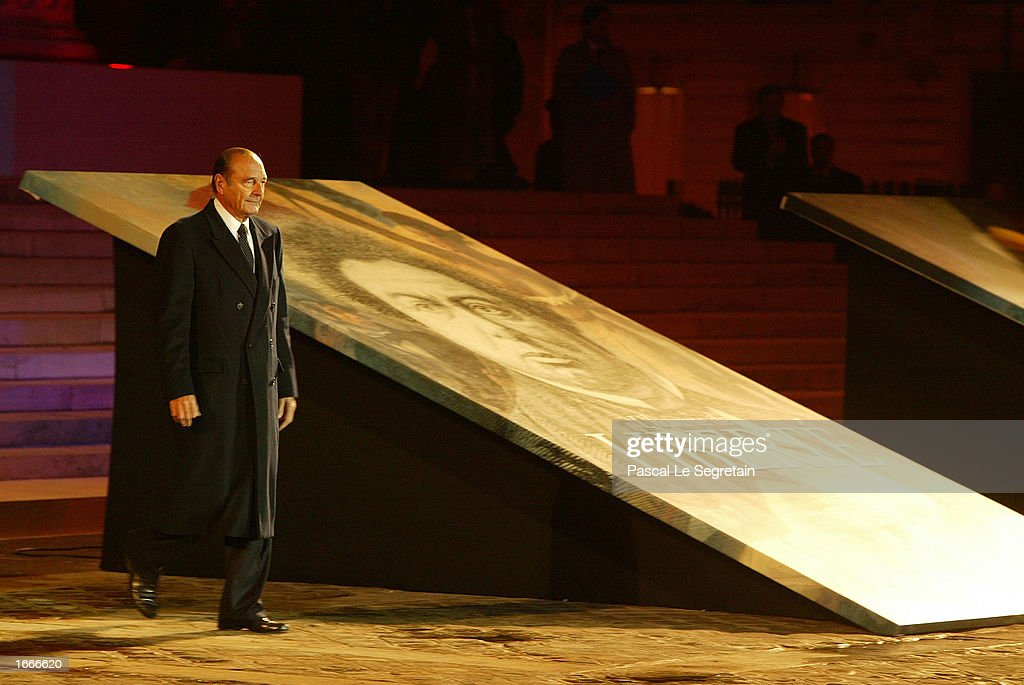 French President Jacques Chirac walks past a portrait of author Alexandre Dumas during a ceremony to transfer Dumas' ashes to the Pantheon November 30, 2002 in Paris, France. The Pantheon is the traditional resting place of the remains of France's greatest historical and cultural figures.