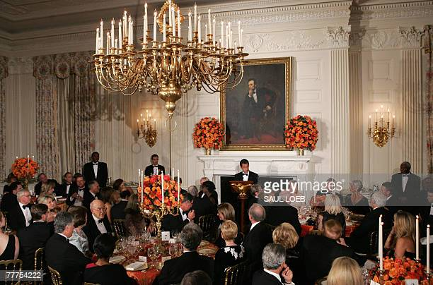 French President Nicholas Sarkozy speaks during a Social Dinner in the State Dining Room of the White House in Washington, DC, 06 November 2007. AFP...