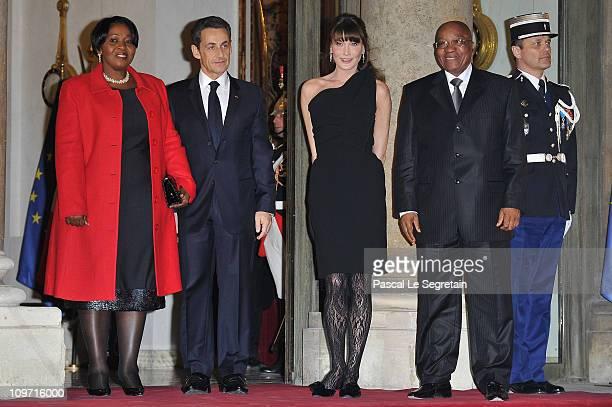 French President Nicolas Sakozy and wife Carla BruniSarkozy South African President Jacob Zuma and wife Gloria Bongi Ngema pose as they arrive to...