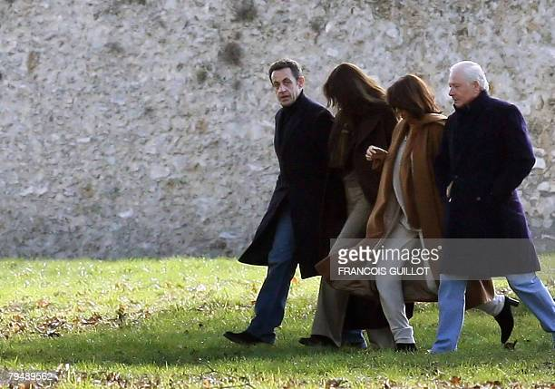 French President Nicolas Sarkozy 53 and his new wife 40yearold Italian exsupermodel Carla Bruni 2ndL who were married yesterday at the Elysee palace...