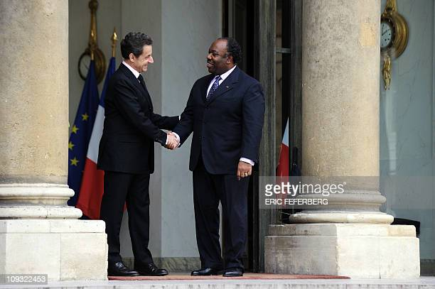 French President Nicolas Sarkozy accompanies his Gabonese counterpart President Ali Bongo Ondimba after a meeting at the Elysee Palace in Paris on...