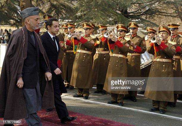 French President Nicolas Sarkozy and Afghan President Hamid Karzai inspect the guard of honor prior to their meeting at the Presidential Palace in...
