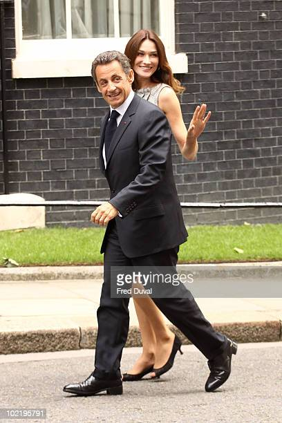 French President Nicolas Sarkozy and Carla BruniSarkozy arrive at Downing Street on June 18 2010 in London England