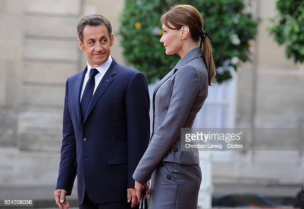 French President Nicolas Sarkozy and First Lady Carla BruniSarkozy stand on the red carpet outside the Elysee Palace as Pope Benedict XVI departs  ...