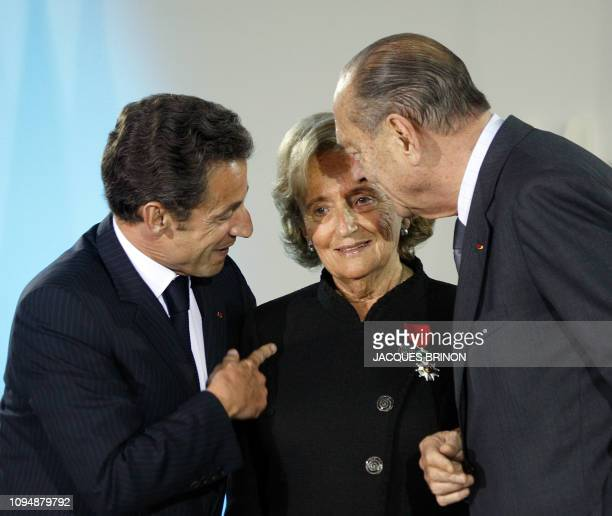 French President Nicolas Sarkozy and former president Jacques Chirac talk with former First Lady Bernadette Chirac after she was awarded with the...