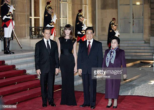 French President Nicolas Sarkozy and French First Lady Carla Bruni Sarkozy pose with Chinese President Hu Jintao and his wife Liu Yongqing attending...