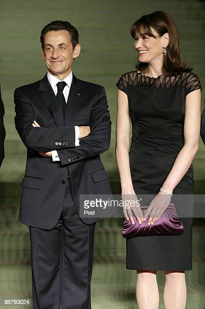 French President Nicolas Sarkozy and French first Lady Carla Bruni arrive to attend the opening of the NATO summit at the Kurhaus on April 3, 2009 in...