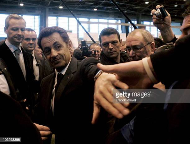 French President Nicolas Sarkozy and French Minister for Agriculture Food Fisheries and Land Management Bruno Le Maire visit the Paris international...
