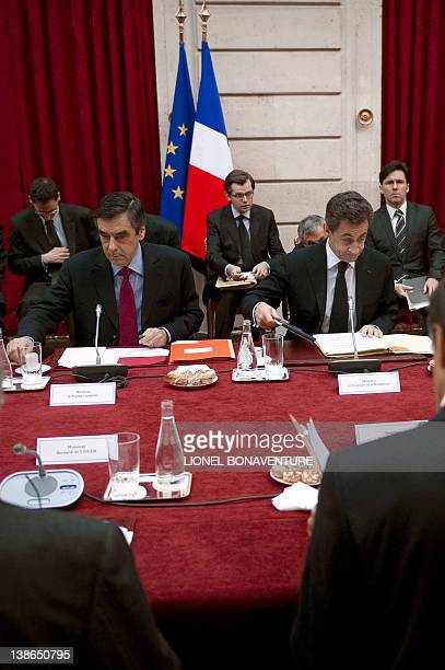 French President Nicolas Sarkozy and French Prime Minister Francois Fillon attend a conference focused on the financing of local authorities with...