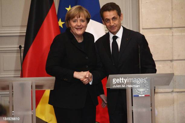 French President Nicolas Sarkozy and German Chancellor Angela Merkel attend a joint press conference for the launch of Eurozone crisis talks at...