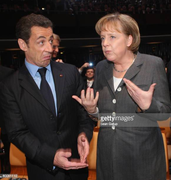 French President Nicolas Sarkozy and German Chancellor Angela Merkel arrive for the opening of the CeBIT technology fair a day before the fair's...