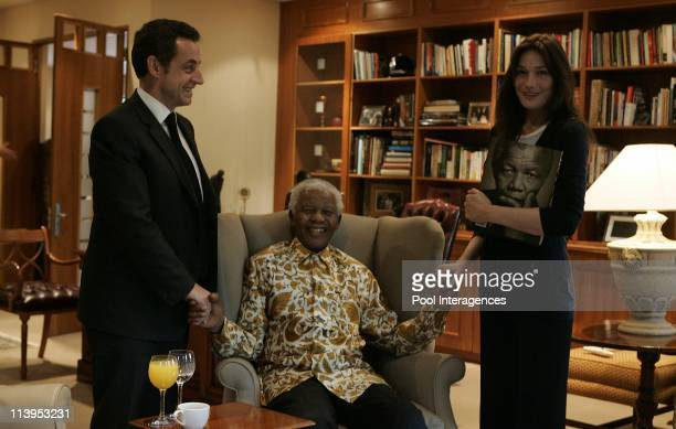 French President Nicolas Sarkozy and his new wife Carla Bruni pose with former South Africa President Nelson Mendela and his wife Graca Machel in...