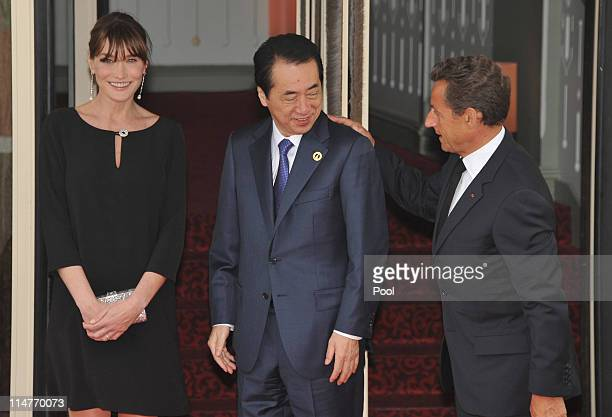French President Nicolas Sarkozy and his pregnant wife Carla BruniSarkozy greet Japanese Prime Minister Naoto Kan upon Kan's arrival at Le Ciro's...
