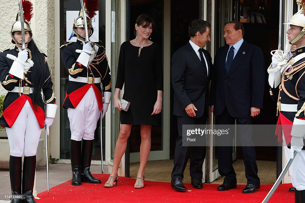 French President Nicolas Sarkozy and his pregnant wife Carla Bruni-Sarkozy greet Italian President Silvio Berlusconi upon Berlusconi's arrival at Le Ciro's Restaurant at the G8 Summit on May 26, 2011 in Deauville, France. France is hosting the G8 Summit, which focuses on issues including African development, the Arab Spring and the Internet.