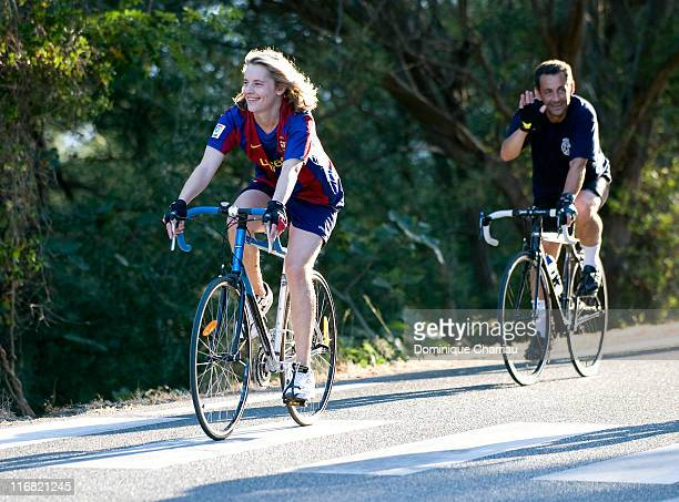 French President Nicolas Sarkozy and his son Pierre go for a cycle during their holiday at Domaine du Cap Negre on August 4 2008 in Cavaliere France