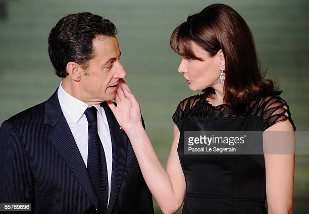 French President Nicolas Sarkozy and his wife Carla Bruni Sarkozy attend the opening of the NATO summit at the Kurhaus on April 3 2009 in Baden Baden...