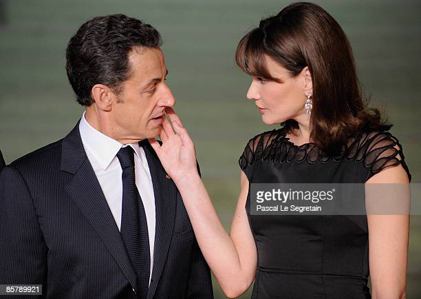 French President Nicolas Sarkozy and his wife Carla Bruni- Sarkozy attend the opening of the NATO summit at the Kurhaus on April 3, 2009 in Baden...