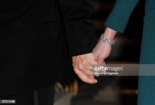 French President Nicolas Sarkozy and his wife Carla BruniSarkozy hold hands as they wait for the arrival of their guests Russian President Dmitry...
