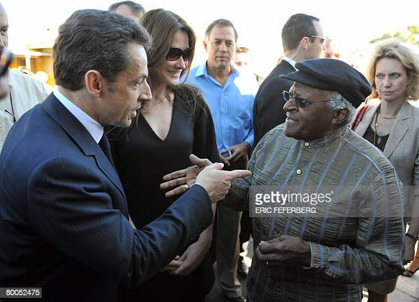 French President Nicolas Sarkozy and his wife Carla BruniSarkozy meet archbishop Desmond Tutu during their visit to Gugulethu AIDS institute near...