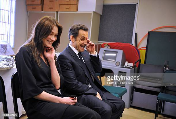 French President Nicolas Sarkozy and his wife Carla BruniSarkozy laugh during their visit to Gugulethu AIDS institute with Archbishop Desmond Tutu on...
