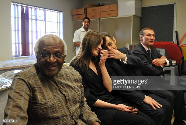 French President Nicolas Sarkozy and his wife Carla BruniSarkozy talk during their visit to the Gugulethu AIDS institute with Archibishop Desmond...