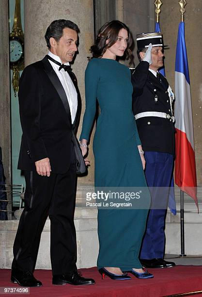 French President Nicolas Sarkozy and his wife Carla BruniSarkozy walk to greet their guests Russian President Dmitry Medvedev and his wife Svetlana...