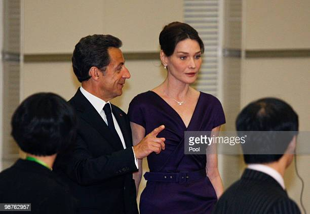 French President Nicolas Sarkozy and his wife Carla BruniSarkozy walk together at a welcome ceremony for foreign leaders before the Opening Ceremony...