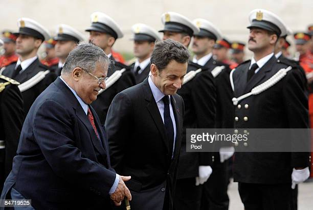 French President Nicolas Sarkozy and Iraqi President Jalal Talabani review an honor guard ahead of their meeting on February 10 2009 in Baghdad Iraq...