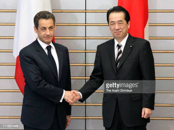 French President Nicolas Sarkozy and Japanese Prime Minister Naoto Kan shakes hands prior to their summit meeting over nuclear crisis at Kan's...