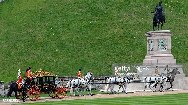 French President Nicolas Sarkozy and Queen Elizabeth II arrive in a state carriage during a welcome ceremony at Windsor Castle on March 26, 2008 in...