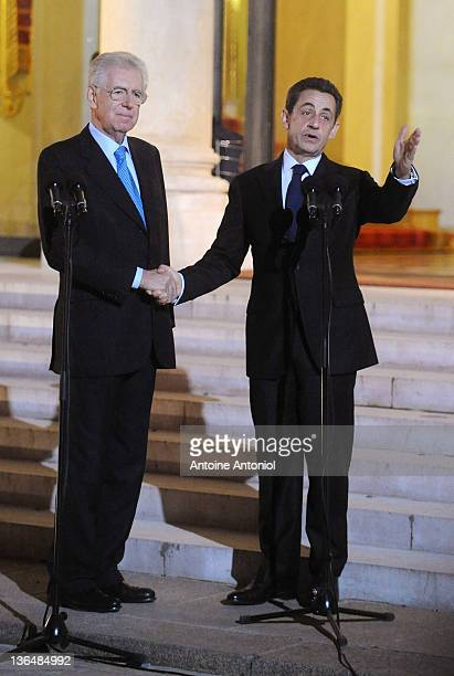 French President Nicolas Sarkozy and recently elected Italian Prime Minister Mario Monti speak after a meeting at the Elysee Palace on January 6,...