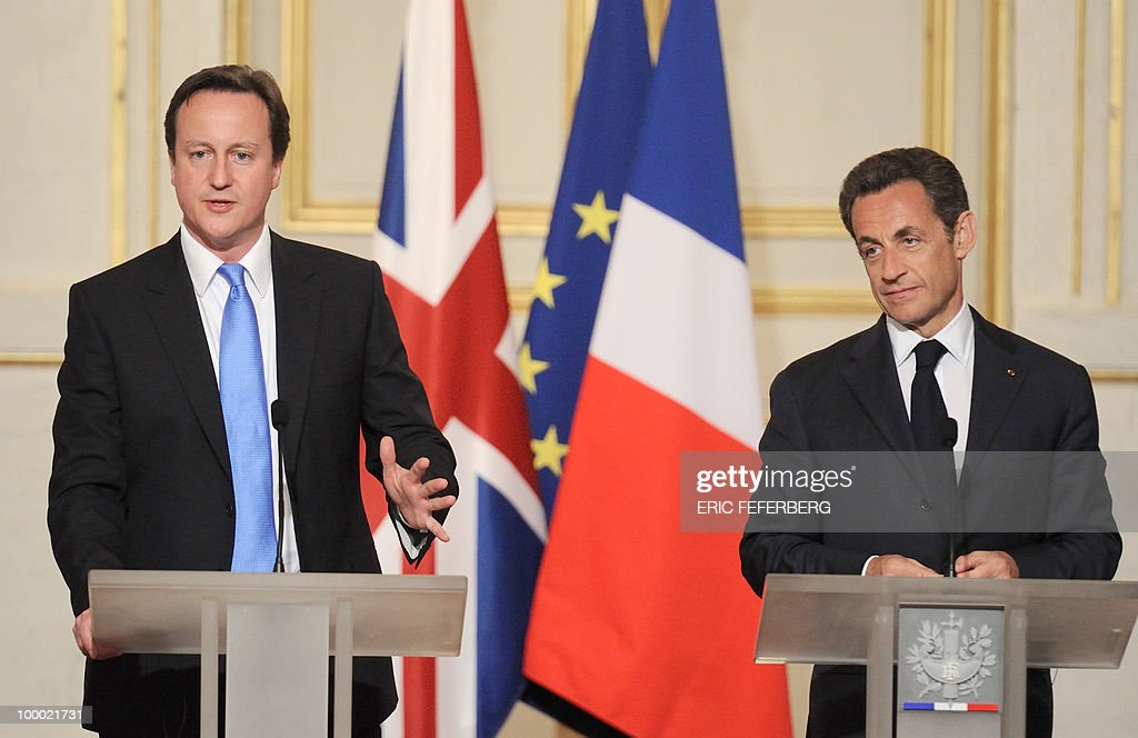 French President Nicolas Sarkozy (R) and the new Britain's Prime minister David Cameron give a press conference after their diner at the Elysee Palace on May 20, 2010 in Paris. Cameron and his coalition deputy unveiled full details today of their 'historic' power-sharing deal, under growing scrutiny for signs of strain.