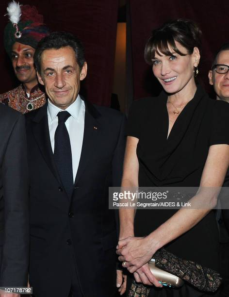 French President Nicolas Sarkozy and wife Carla BruniSarkozy attend the Aides Gala Diner at Les BeauxArts de Paris on November 27 2010 in Paris France