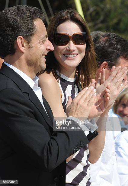 French President Nicolas Sarkozy and wife First Lady Carla BruniSarkozy applaud as they attend the trophy ceremony of the first edition of the...