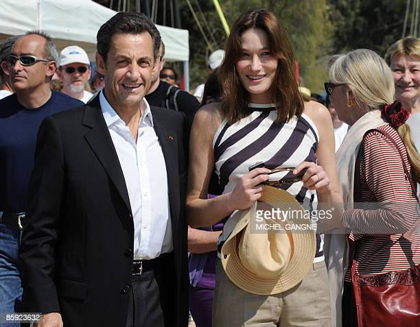 French President Nicolas Sarkozy and wife First Lady Carla BruniSarkozy arrive with Marisa BruniTedeschi Carla Sarkozy's mother to attend the trophy...