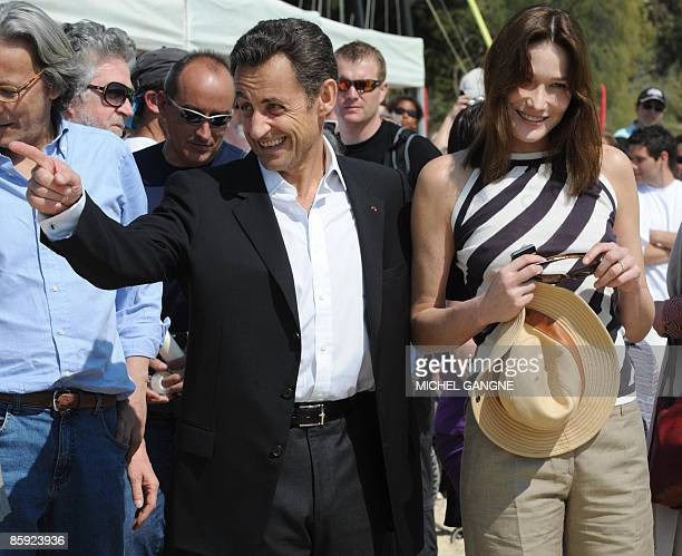 French President Nicolas Sarkozy and wife First Lady Carla BruniSarkozy arrive to attend the trophy ceremony of the first edition of the Virginio...