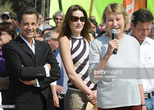 French President Nicolas Sarkozy and wife First Lady Carla BruniSarkozy listen to Marisa BruniTedeschi Carla Sarkozy's mother as attending the trophy...