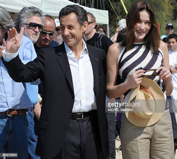 French President Nicolas Sarkozy and wife First Lady Carla BruniSarkozy waves upon arrival to attend the trophy ceremony of the first edition of the...