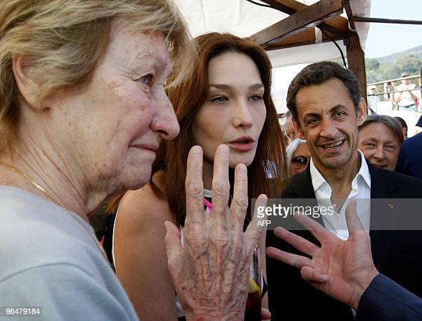 French President Nicolas Sarkozy and wife First Lady Carla BruniSarkozy with her mother Marisa BruniTedeschi attend the trophy ceremony of the first...
